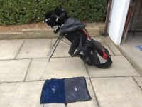 Caddy and set of right handed golf clubs and irons