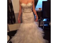 Brand new one of a kind bespoke american import wedding dress from impressions.