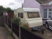 DETHLEFFS VINTAGE 4 BIRTH CARAVAN IN LOVELY CONDITION AND NOT GAWDY COLOURS ,NO DAMP,AWNING ,KIT