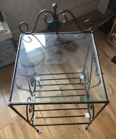Designer metal bedside table in black with glass top for sale