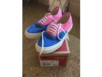 Ladies pink, white and blue Vans canvas shoes Size 36)