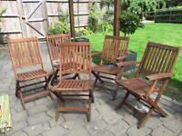 Teak garden chairs, good condition, two with arm rests, 3 without arm rests.