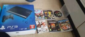 Boxed PlayStation 3 with games