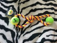Purple, yellow and orange plaited rope with green and yellow tennis ball at each end