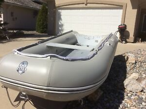 Inflatable  Titan boat and 15 hp ..2cyl Mercury Motor
