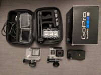 GoPro Hero 4 with 2 extra batteries, 64GB memory card and various clips and extras.
