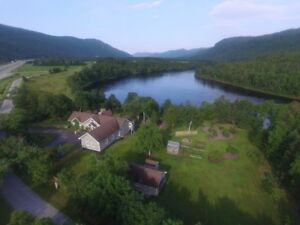 Luxury Living on 1.2 Acres of Riverfront in Little Rapids!