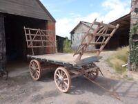 Vintage wooden wheeled hay wagon