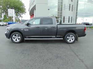 2015 RAM 1500 Sport 4x4 Crew Cab with a 6.4 Box