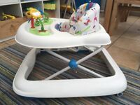 White baby walker with animal print seat and insect toys