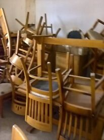 around 30 chairs and 14 pine looking tables, ,