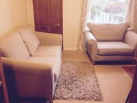 2 seater fabric sofa and matching love seat beige. 400£ or nearest offer
