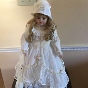 Beautiful Porcelain Doll stand included