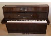 Calisia upright piano, recently serviced, cleaned and tuned. Hardly used, condition very good.