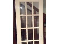 Two matching glass panelled solid doors