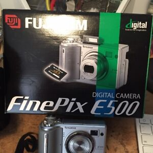 Fugi Digital camera, battery charger, and case for sale