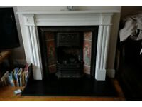 Victorian look fireplace with pink tiles and gas fire with coals
