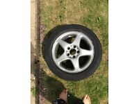 Car alloy wheel and tyre part worn