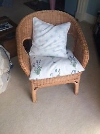 Wicker Chair, Sturdy and in Good Condition, with two cushions.