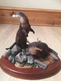 Stunning otters figurine