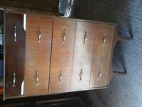 mahognany chest of drawers.