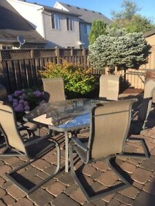 Glass table with lazy susan and 6 sling back chairs