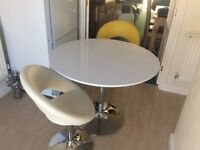 White high gloss kitchen table and two pump chairs