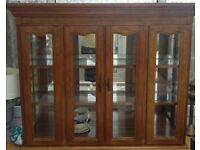 Oak Glass display cabinet no base great condition and wired with light