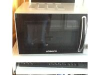Ambiano microwave oven in good condition and working order as well as a stainless steel kettle