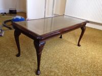 Medium sized coffee table, wooden frame glass top.