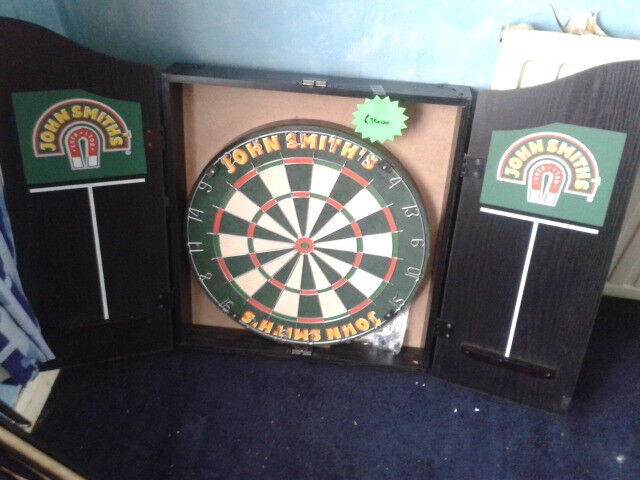 Dartboard and surround cabinet