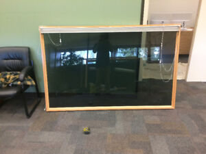 Tinted plexiglass window with oak trim