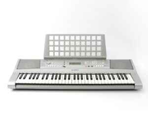 Yamaha keyboard with foldable stand