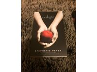 Twilight books by Stephanie Meyer; twilight, new moon and breaking down