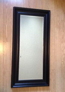 Tall brown mirror