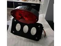 Side number plate holder