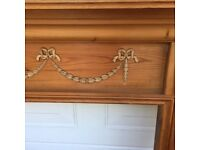 Period style wooden fire surround with carving decoration
