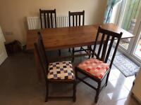 Dining table and 4 chairs £50ono