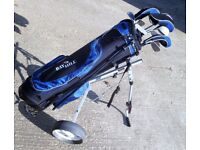 Set of Bay Hill 14 Golf Clubs in bag on trolley some with individual bag on club.