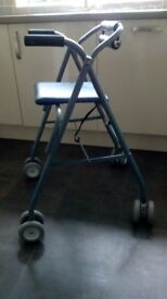Walker with wheels and seat