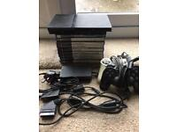 Slim Playstation 2, complete with 9 games.