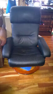 Black leather reclining chairs with foot stools