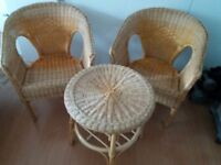 Two Lloyd Loom style chairs and matching table in good condition but slightly faded with sun.