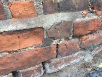 Old red bricks, paving slabs, concrete fence post etc