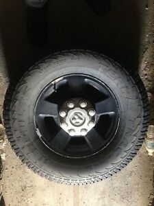 Dodge factory aluminum 8 bolt rims with tires