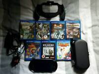 Playstation Vita OLED with 7 Great games , Grip , carry case and charger