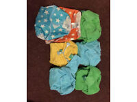 5 Tots Bots Bamboo nappies and 2 wraps