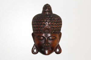 Beautiful wooden Buddha mask, mindfulness, meditation, wall art