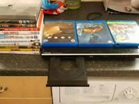 Toshiba blu ray player with 3 blu rays and 11 Dvd's