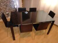 Glass dining table with 6 real leather chairs